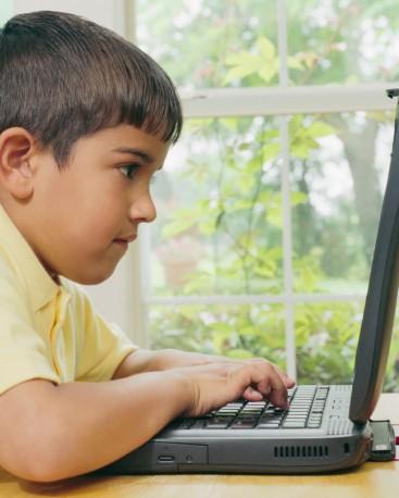 Boy Typing on Laptop