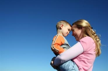 iStock mom holding son_New